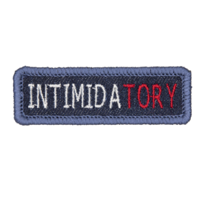 blue denim patch embroidered with the word INTIMIDATORY