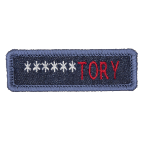 blue denim patch embroidered with the word ******TORY