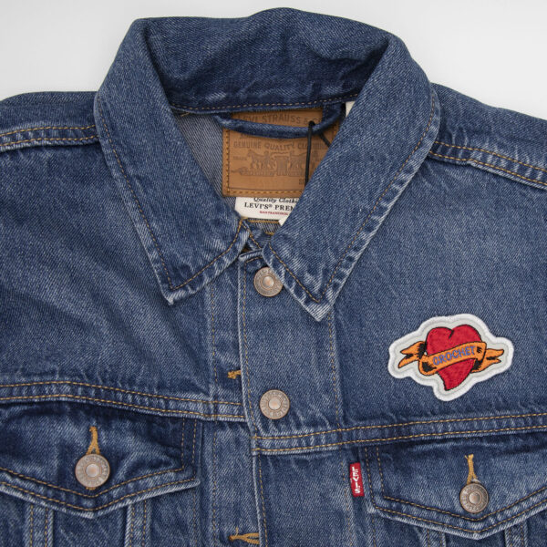 demin jacket with crochet heart tattoo embroidered patch by The Unruly Stitch
