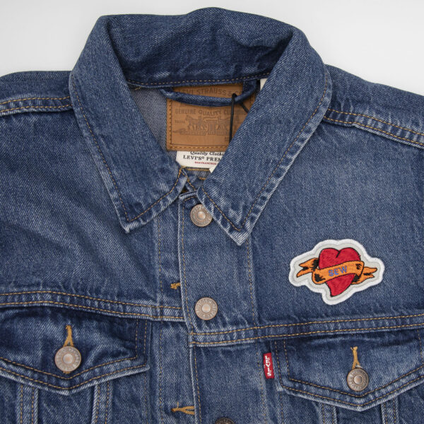 denim jacket wirh sew heart tattoo embroidered patch by The Unruly Stitch