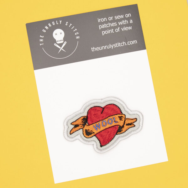 postcard with WOOL heart tattoo embroidered patch by The Unruly Stitch