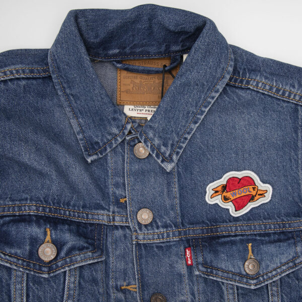 denim jacket decorated with WOOL heart tattoo embroidered patch by The Unruly Stitch