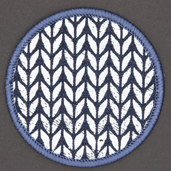 patch made from blue denim screen printed with a garter stitch print and finished with an embroidered border