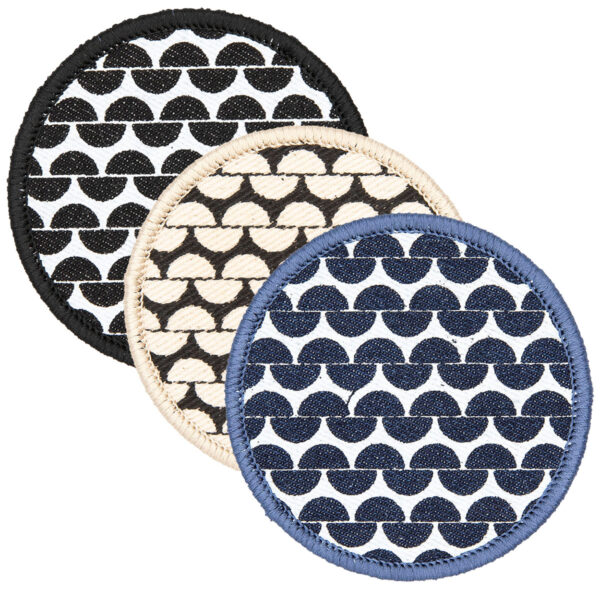 3 round patches screen printed with garter stitch design and finished with embroidered border black, cream. blue