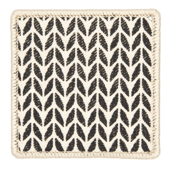patch made from cream denim screen printed with a stocking stitch print and finished with an embroidered border