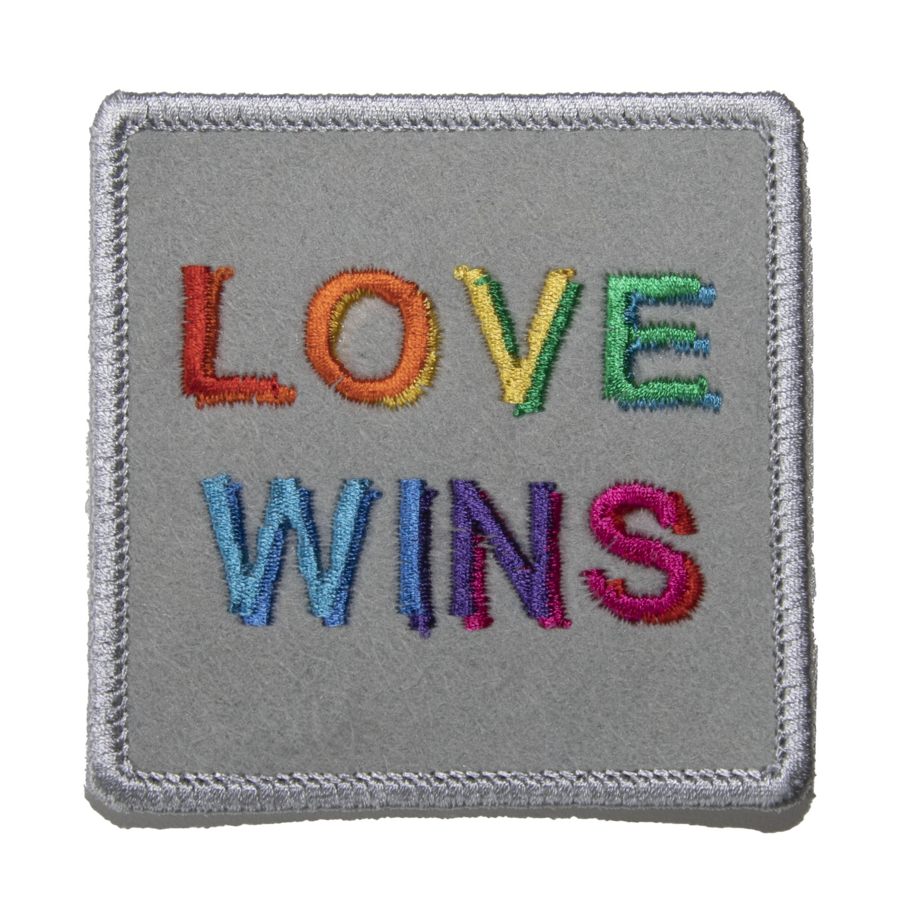 embroidered square patch LOVE WINS in rainbow letters of silver felt background