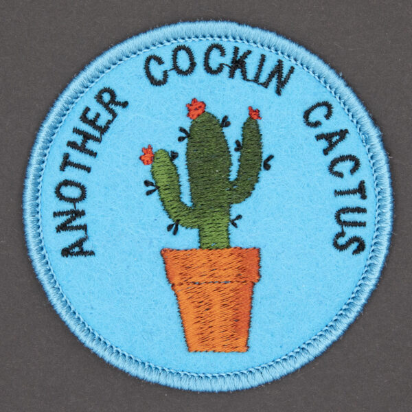 round embroidered patch picture of cactus in pot and text another cockin cactus on turquoise blue