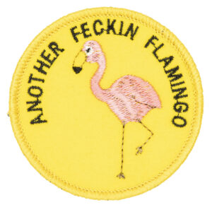 round embroidered patch picture of pink flamingo and text another feckin flamingo on yellow