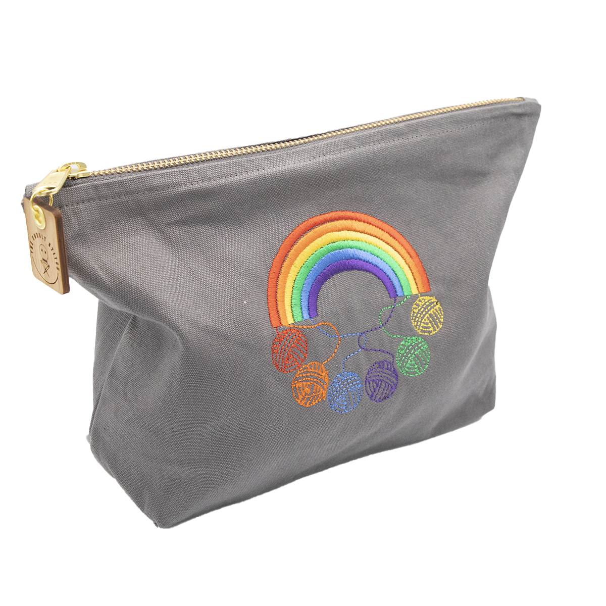 Zipped cotton pouch embroidered with a rainbow and 6 balls of yarn in rainbow colours