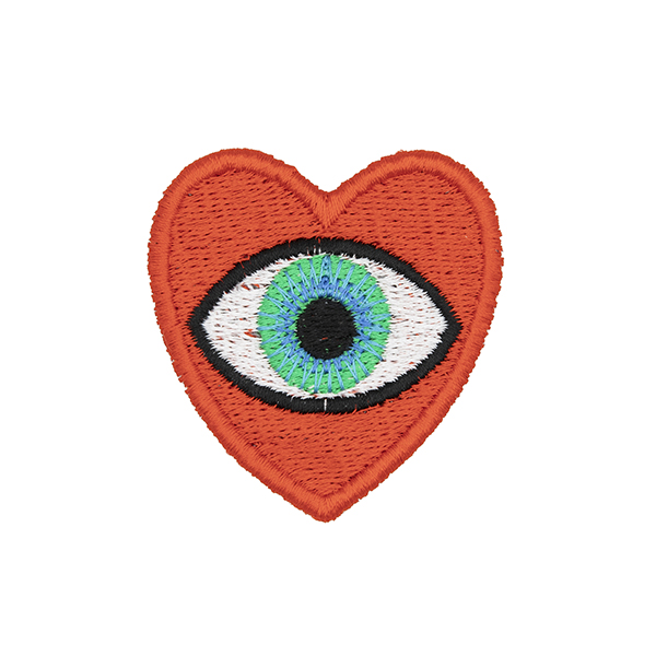 medium embroidered patch, red heart containing a blue eye photographed on a white background