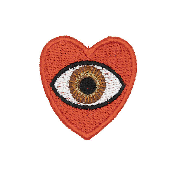 medium embroidered patch, red heart containing a brown eye photographed on a white background
