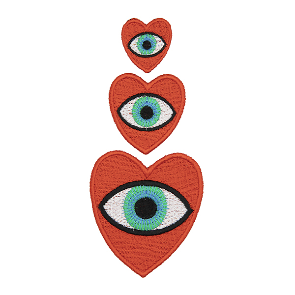 three embroidered patches, all read hearts with brown eye in the centre. Patches are large, medium and small. Displayed in a vertical line on a white background.