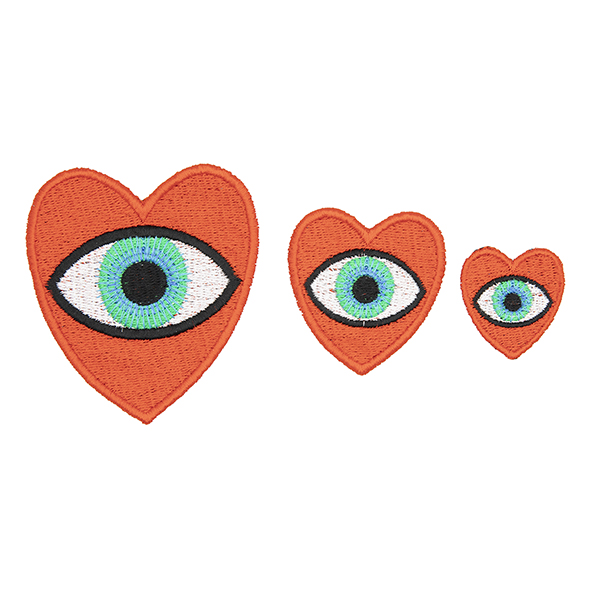 three embroidered patches, all read hearts with blue eye in the centre. Patches are large, medium and small. Displayed in a horizontal line on a white background.
